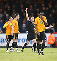 Brian Saah of Cambridge United is shown the red card by referee Rob Whitton during the Blue Square Bet Premier match between Cambridge United and Wrexham at the Abbey Stadium, Cambridge on 22nd January, 2011 .© Kevin Coleman 2011