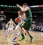 SIOUX FALLS, SD - MARCH 10: Ian Thiesen #42 from South Dakota State drives into the defense of Chris Kading #34 from North Dakota State in the first half of the Summit League Championship Tournament game Tuesday at the Denny Sanford Premier Center in Sioux Falls, SD. (Photo by Dave EggenInertia)