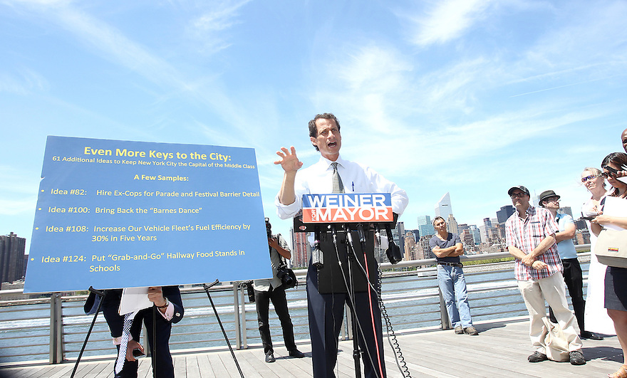 Anthony Weiner speaks to reporters during making a spot at the Gantry Plaza State Park Promenade on Monday, August 5, 2013 in Queens, New York. (AP Photo/ Donald Traill)