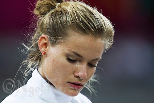 12 AUG 2012 - LONDON, GBR - Adrienn Toth (HUN) of Hungary prepares for a match during the women's London 2012 Olympic Games Modern Pentathlon fencing at The Copper Box in the Olympic Park, in Stratford, London, Great Britain .(PHOTO (C) 2012 NIGEL FARROW)