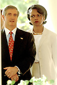 White House Chief of Staff Andy Card and National Security Advisor Condoleezza Rice look on as United States President George W. Bush holds a full press conference in the Rose Garden of the White House in Washington, DC on July 30, 2003.  He took questions for almost an hour on a variety of questions including Iraq, tax cuts, and the upcoming election.<br /> Credit: Ron Sachs / CNP