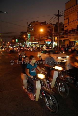 Asia, Vietnam, Ho Chi Minh City (Saigon). Typical motorbike traffic.