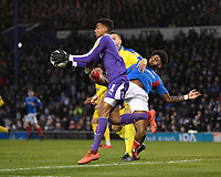 Ellis Harrison of Portsmouth just catches AFC Wimbledon keeper Nathan Trott during Portsmouth vs AFC Wimbledon, Sky Bet EFL League 1 Football at Fratton Park on 11th January 2020