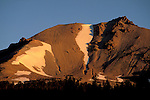 Morning sunrise light on the east face of volcano mountain summit, Lassen Volcanic National Park, California