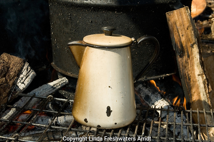 Old coffee pot on a campfire