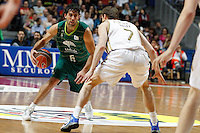 01.04.2012 SPAIN - ACB match played between Real Madrid vs Unicaja  at Palacio de los deportes stadium. The picture show Berni Rodriguez (Unicaja) and  Martynas Pocius (Lithuanian small forward of Real Madrid)