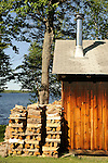 Woodpile and cabin at the Birches Resort, Moosehead Lake.