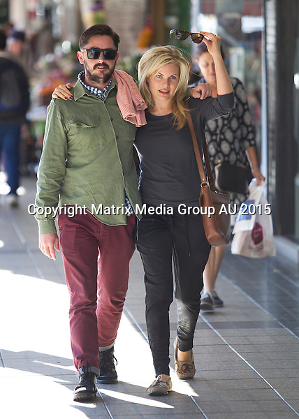 9 MAY 2015 SYDNEY AUSTRALIA<br /> <br /> EXCLUSIVE PICTURES<br /> <br /> Bonnie Sveen pictured with a mystery man enjoying a Saturday morning together in Balmain after a sleepover. The loved up couple emerged from Bonnie's place mid morning and took a drive to Balmain where they had breakfast at a cafe on Darling Street followed by a stroll through Rozelle Markets. Bonnie was noted to be wearing what appeared to be an 'engagement ring' on her ring finger as she strolled arm in arm with her clearly smitten new boyfriend. The couple continued their morning with a short drive down the street to Orange Grove market where they picked up some fresh fruit and vege.