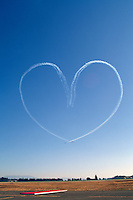 Canadian Forces Snowbirds writing Heart in Sky and performing Aerobatic Maneuver with Smoke