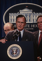 ***FILE PHOTO*** George H.W. Bush Has Passed Away<br /> Washington DC., USA, 1989<br /> President George H.W. Bush answers reporters questions during a short news conference in the press briefing room of the White  House <br /> CAP/MPI/MRN<br /> &copy;MRN/MPI/Capital Pictures