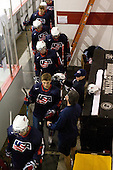 John Moore (US - 14), Steve Castelletti (US - Equipment Manager), Ryan Bourque (US - 17), Mac Moore (US - Assistant), Vinny Saponari (US - 10) - Team USA defeated Team Russia 6-0 in their final game during the 2009 USA Hockey National Junior Evaluation Camp on Saturday, August 15, 2009, in the USA (NHL-sized) Rink in Lake Placid, New York.