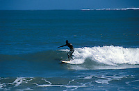 Black person surfing in Cahuita National Park on the Caribbean coast of Costa Rica