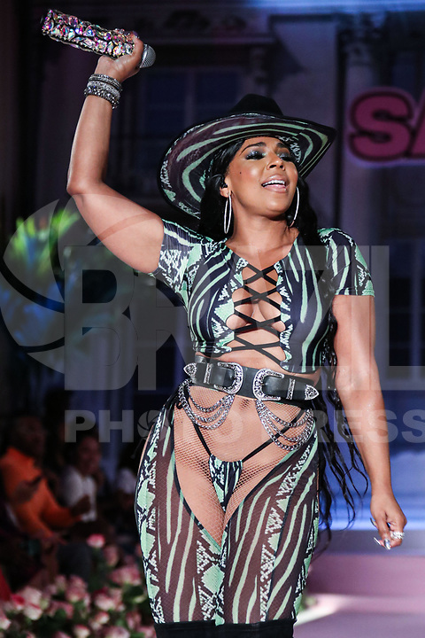 MANHATTAN, NEW YORK CITY, NEW YORK, USA - SEPTEMBER 08: Singer Ashanti performs onstage at the PrettyLittleThing x Saweetie runway show during New York Fashion Week: The Shows held at The Plaza Hotel on September 8, 2019 in Manhattan, New York City, New York, United States.