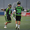 Joe LoCascio #5 of the New York Lizards, left, gets congratulated by Steve DeNapoli #70 after scoring a goal in the second quarter of a Major League Lacrosse game against the Ohio Machine at Shuart Stadium in Hempstead, NY on Thursday, June 29, 2017.