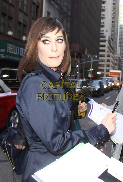 Lizzy Caplan<br /> at the Ed Sullivan Theater for an appearance on Late Show with David Letterman in New York City, USA.<br /> September 25th, 2013 <br /> half length blue mac trench coat side signing autographs <br /> CAP/MPC/RW<br /> &copy;RW/ MediaPunch/Capital Pictures