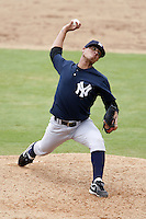 July 10, 2009:  Relief Pitcher Manuel Barreda (12) of the GCL Yankees delivers a pitch during a game at Bright House Networks Field in Clearwater, FL.  The GCL Yankees are the Gulf Coast Rookie League affiliate of the New York Yankees.  Photo By Mike Janes/Four Seam Images
