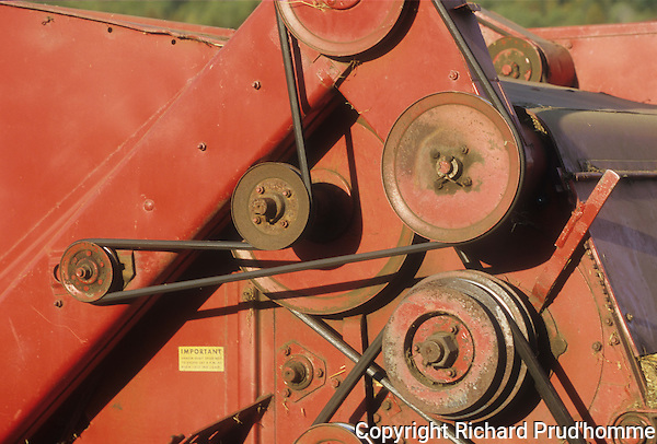 pulleys and belts on an old combine