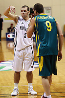 Tall Blacks guard Mike Fitchett signals a teammate as Peter Crawford walks past during the International basketball match between the NZ Tall Blacks and Australian Boomers at TSB Bank Arena, Wellington, New Zealand on 25 August 2009. Photo: Dave Lintott / lintottphoto.co.nz