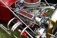 Close up of the small block engine on a red model T carrying the Edelbrock brand name at the 2010 Wings 'n' Wheels Showcase, Galway, New York. The engine of highly polished chrome with red accents.