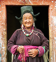 Local woman holding prayer beads, Ladakh, India