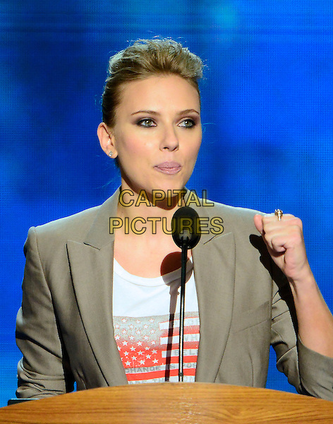 Scarlett Johansson.at the 2012 Democratic National Convention in Charlotte, North Carolina, USA, September 6th, 2012.  .half length hand fist podium microphone speaking quiff silver grey gray blazer jacket white t-shirt american flag .CAP/ADM/CNP/RS.©Ron Sachs/CNP/ADM/Capital Pictures.
