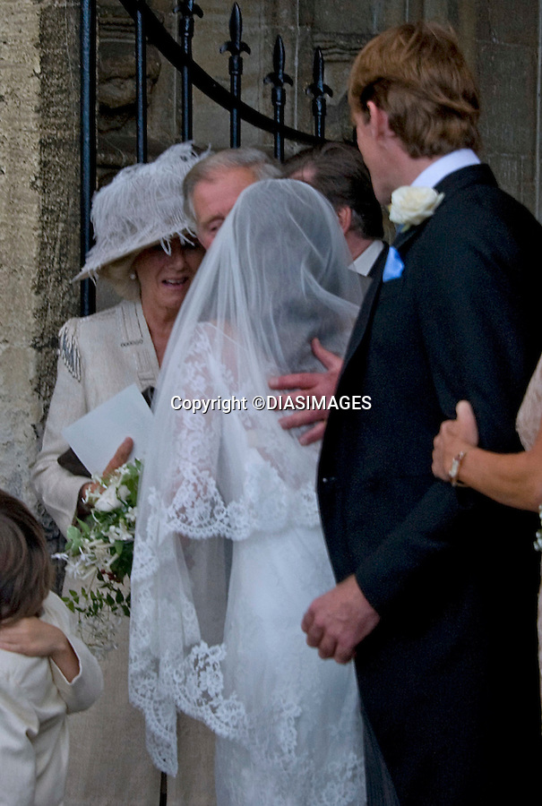 """PRINCE CHARLES KISSES THE BRIDE.BEN ELLIOT AND MARY CLARE WINWOOD WEDDING.Camilla, Duchess of Corwall's nephew Ben Elliot and Mary Clare Winwood daughter of musician Steve Winwood tied the knot at the Church of St Peter & St Paul, Northleach_Gloucestershire_10/09/2011.Mandatory Credit Photo: ©DiasImages/NEWSPIX INTERNATIONAL..**ALL FEES PAYABLE TO: """"NEWSPIX INTERNATIONAL""""**..IMMEDIATE CONFIRMATION OF USAGE REQUIRED:.Newspix International, 31 Chinnery Hill, Bishop's Stortford, ENGLAND CM23 3PS.Tel:+441279 324672  ; Fax: +441279656877.Mobile:  07775681153.e-mail: info@newspixinternational.co.uk"""
