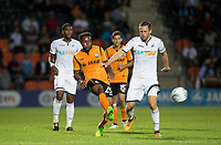 Jean Akpa-Akpro of Barnet plays a pass past Gylfi Sigurosson of Swansea City during the 2017/18 Pre Season Friendly match between Barnet and Swansea City at The Hive, London, England on 12 July 2017. Photo by Andy Rowland.