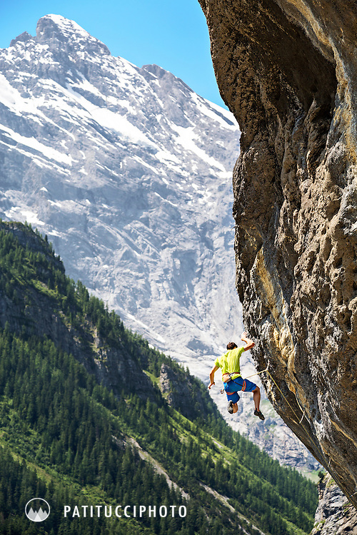 Sport climbing at the tremendously hard and steep limestone crag at Gimmelwald, Switzerland, above the Lauterbrunnen Valley. The climber is caught falling off the route.