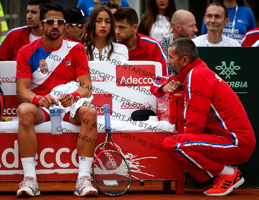 Davis Cup 2016 Quarter Final<br /> Srbija v Velika Britanija<br /> Janko Tipsarevic SRB v Kyle Edmund GBR<br /> Janko Tipsarevic (L) and team captain Bogdan Obradovic<br /> Beograd, 15.07.2016.<br /> Foto: Srdjan Stevanovic/Starsportphoto.com&copy;