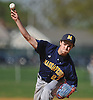 Chris DeSousa #27, Massapequa pitcher, delivers to the plate in the bottom of the second inning of a Nassau County varsity baseball game against host Farmingdale High School on Tuesday, May 2, 2017. He held Farmingdale scoreless over 4 2/3 innings of work and was the winning pitcher of record in Massapequa's 10-1 victory.