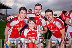 Rathmore mascot Padraig Murphy celebrates with Rathmore captain  Brendan O'Keeffe, Paul Murphy and Aidan O'Mahony after they defeated Legion in the O'Donoghue cup final in Fitzgerald Stadium on Saturday