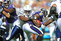 Sep. 20, 2009; San Diego, CA, USA; San Diego Chargers defensive end (74) Jacques Cesaire makes a tackle against the Baltimore Ravens at Qualcomm Stadium in San Diego. Baltimore defeated San Diego 31-26. Mandatory Credit: Mark J. Rebilas-