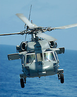 An SH-60F launches from USS Abraham Lincoln.