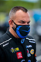 Jul 10, 2020; Clermont, Indiana, USA; NHRA top fuel driver Tony Schumacher wears a face mask during testing for the Lucas Oil Nationals at Lucas Oil Raceway. This will be the first race back for NHRA since the COVID-19 pandemic. Mandatory Credit: Mark J. Rebilas-USA TODAY Sports