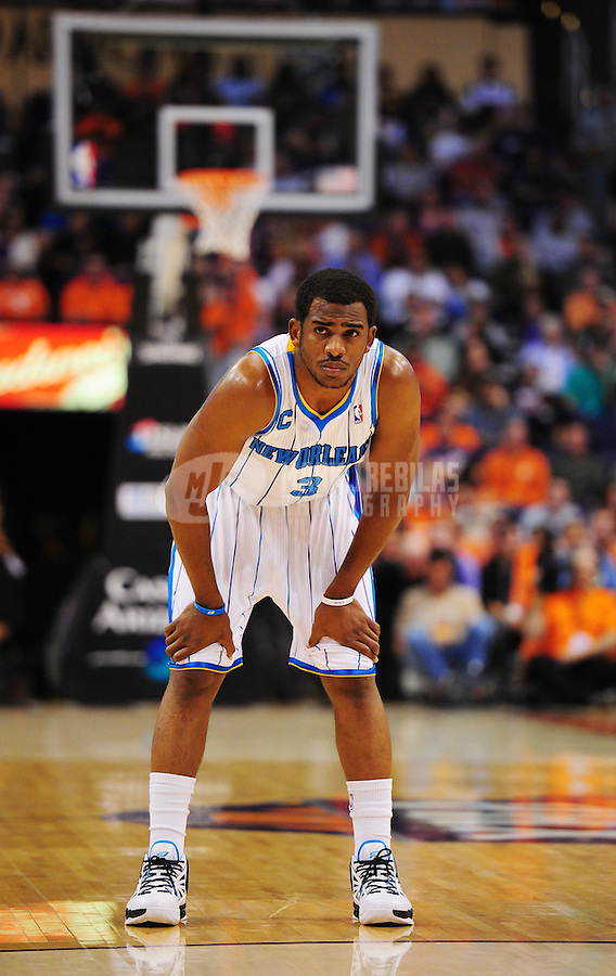 Mar. 25, 2011; Phoenix, AZ, USA; New Orleans Hornets guard (3) Chris Paul against the Phoenix Suns at the US Airways Center. The Hornets defeated the Suns 106-100. Mandatory Credit: Mark J. Rebilas-