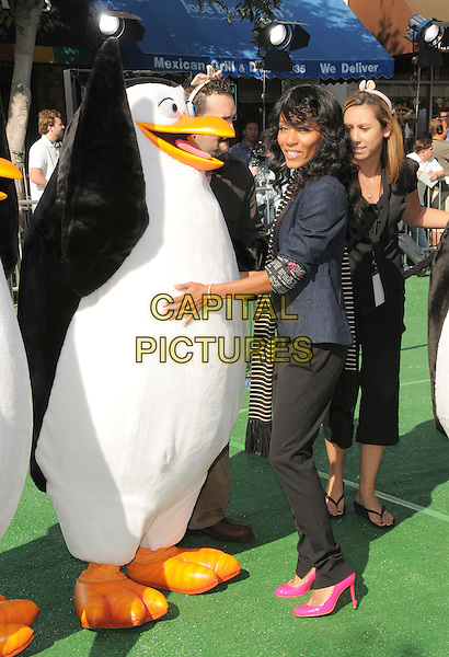 "JADA PINKETT SMITH.The Dreamworks L.A. Premiere of ""Madagascar: Escape 2 Africa"" held at The Mann's Village Theatre in Westwood, California, USA..October 26th, 2008                                                                     .full length black shoes pink heels striped stripes scarf trousers white top blue jacket penguins.CAP/DVS.©Debbie VanStory/Capital Pictures."