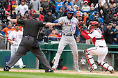 Home plate umpire Marty Foster (60), left calls New York Mets shortstop Amed Rosario (1), center, safe after he scored on an Asdrubal Cabrera double in the seventh inning against the Washington Nationals at Nationals Park in Washington, D.C. on Saturday April 7, 2018.  Washington Nationals catcher Pedro Severino (29), right, defends on the play. The Mets won the game 3-2.<br /> Credit: Ron Sachs / CNP<br /> (RESTRICTION: NO New York or New Jersey Newspapers or newspapers within a 75 mile radius of New York City)
