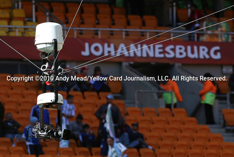 14 JUN 2010: A camera on wires floats above the stadium field. The Netherlands National Team defeated the Denmark National Team 2-0 at Soccer City Stadium in Johannesburg, South Africa in a 2010 FIFA World Cup Group E match.