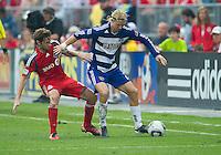 July 24, 2010 FC Dallas defender/midfielder Brek Shea #20 and Toronto FC midfielder Mista #10 in action during a game between FC Dallas and Toronto FC at BMO Field in Toronto..Final score was 1-1.