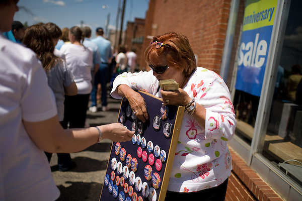 May 4, 2008. Marion, NC.. Just 2 days before the North Carolina primary, former president Bill Clinton campaigned across rural western North Carolina, stumping for his wife. Senator Hillary Clinton, in her drive for rural and working class votes.. Linda Hall, of Illinois, sells pins to help support the campaign, and herself.