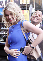 NEW YORK, NY - July 11: Sara Haines co-host of The View  gets photobombed by ABC security while leaving Good Morning America in New York City on July 11, 2018 Credit: RW/MediaPunch