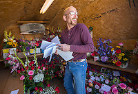 NWA Democrat-Gazette/JASON IVESTER<br /> Justin Van Horn retrieves finished orders to be delivered Monday, Feb. 13, 2017, at Springdale Flower Shop. Rusty Eldridge, owner, estimates the shop will sell between 3,000 and 4,000 roses for the Valentine's Day holiday.