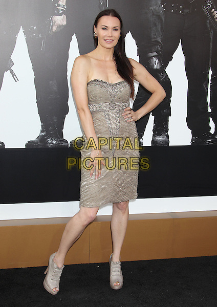 Jon Mack.'The Expendables 2' premiere held at The Grauman's Chinese Theatre, Hollywood, California, USA..15th August 2012.full length dress hand on hip beige clutch bag gold strapless .CAP/ADM/RE.©Russ Elliot/AdMedia/Capital Pictures.