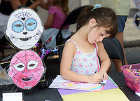 Julia Hansel, 5 of Whitehouse Station, New Jersey uses crayons to color a drawing during Doylestown Arts Fest  September 10, 2016 in Doylestown, Pennsylvania.  (Photo by William Thomas Cain)