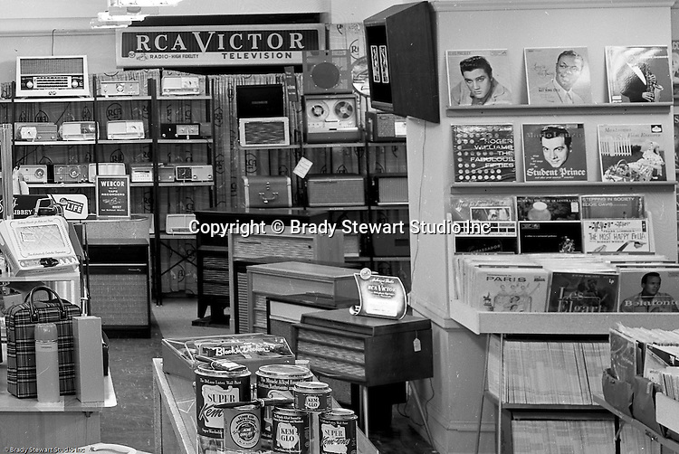 Client: Eiben and Irr Company<br /> Ad Agency:  Eiben and Irr Marketing<br /> Products: Department Store items<br /> Location: Wood Street and Liberty Avenue in Pittsburgh<br /> <br /> Location photography for Eiben and Irr's Holiday Catalog. New RCA radios and record players, 1950's 33 record albums and Kem Glo paints for sale at Eiben and Irr Department Store.  Eiben and Irr Jewelry and Department Store operated in downtown Pittsburgh at the corner of Wood Street and Liberty Avenue from 1953-1979.