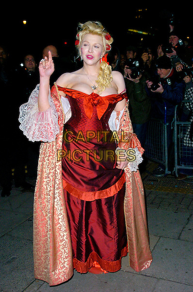 COURTNEY LOVE.Arrives at the pantomime themed fancy dress party reception for Matt Lucas & Kevin McGee following their civil partnership ceremony (wedding) earlier the same day, Banquetting House, Whitehall, London, England, .17th December 2006..full length funny costume red dress low cut cleavage hair lipstick heart painted on face cheek cardigan jacket gold hand finger.CAP/CAN.©Can Nguyen/Capital Pictures