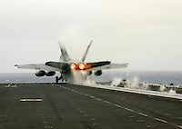 060803-N-7981E-110 Pacific Ocean (August 3, 2006)- An F/A-18F Superhornet of Strike Fighter Squadron (VFA) 2 is one of the last aircraft to launch from the flight deck of the Nimitz-class aircraft carrier USS Abraham Lincoln (CVN-72) as Lincoln unloads her air wing off the coast of California. The fixed-wing aircraft of embarked Carrier Air Wing 2 departed Lincoln for their home bases today after a five-month Western Pacific deployment. U.S.  Navy photo by Mass Communications Specialist Seaman James R. Evans (RELEASED)