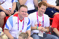 PICTURE BY ALEX BROADWAY /SWPIX.COM - 2012 London Paralympic Games - Day Six - Swimming, Aquatic Centre, Olympic Park, London, England - 04/09/12 - NPD John Atkinson and Prince Harry watch from the stands.