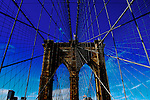 Image of Brooklyn Bridge against dark blue sky, New York City.