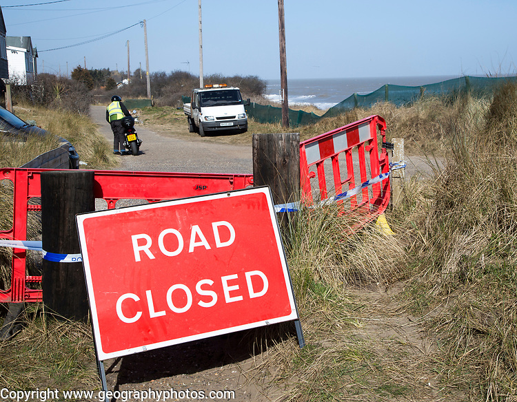 March 2018, Clifftop property collapsing due to coastal erosion after recent storm force winds, Hemsby, Norfolk, England, UK Road Closed sign
